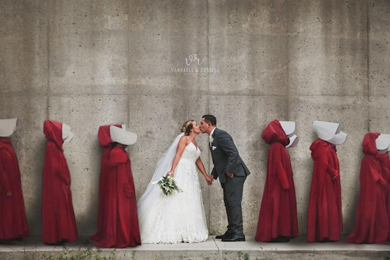 A wedding portrait shot at the location for Gilead's gruesome Wall - with women in red robes digitally added - has sparked controversy. Photo: Courtesy of Van Daele & Russell.