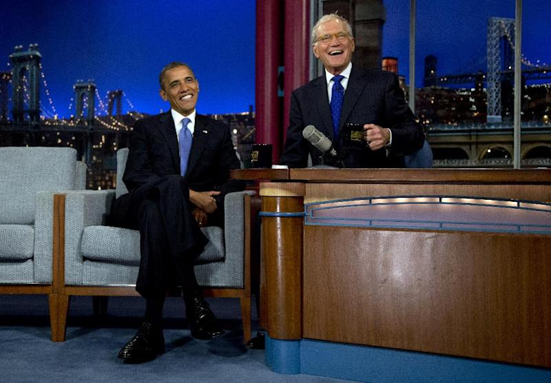 "President Barack Obama sits with David Letterman on the set of the ""Late Show With David Letterman"" at the Ed Sullivan Theater, Tuesday, Sept. 18, 2012, in New York. (AP Photo/Carolyn Kaster)"