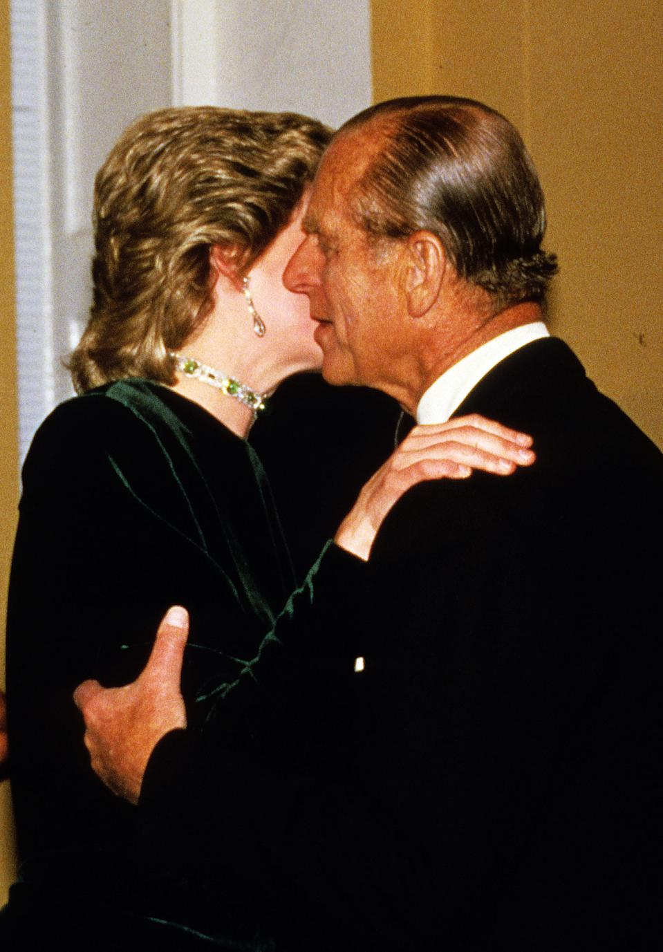 LONDON:  The Duke of Edinburgh receives a kiss from Diana, Princess of Wales in London.  (Photo by Anwar Hussein/WireImage)