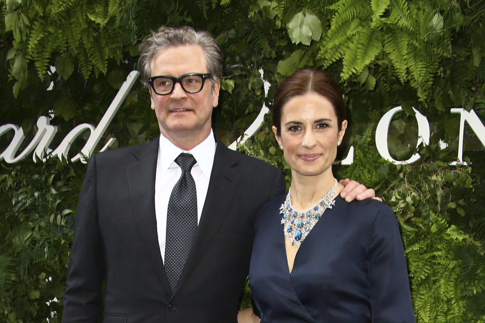 Actor Colin Firth, left, and Livia Firth pose for photographers upon arrival at the Chopard store launch in London, Monday, June 17, 2019. (Photo by Joel C Ryan/Invision/AP)