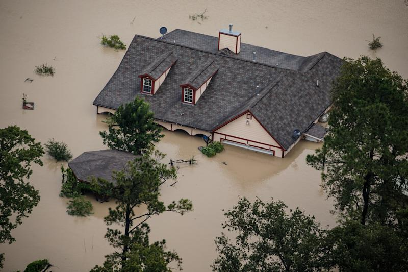 A Houston house sits submerged in floodwater after Hurricane Harvey. (Marcus Yam/Los Angeles Times via Getty Images)