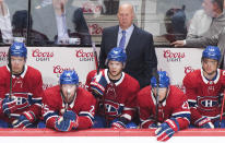 Montreal Canadiens coach Claude Julien and players Nick Suzuki (14), Ryan Poehling (25), Nick Cousins (21) and Max Domi watch from the bench during the third period of the team's NHL hockey game against the Chicago Blackhawks on Wednesday, Jan. 15, 2020, in Montreal. (Graham Hughes/The Canadian Press via AP)