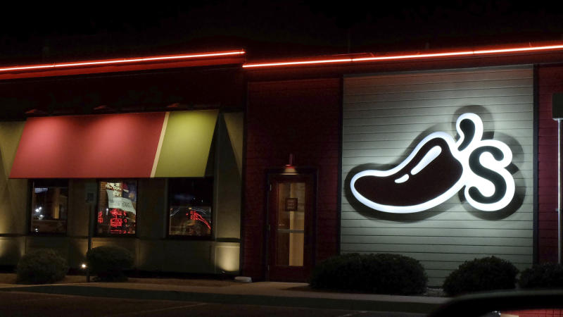 A Chili's restaurant logo stands lit in El Paso, Tex., Wednesday, Oct. 23, 2019. (AP Photo/Rogelio V. Solis)
