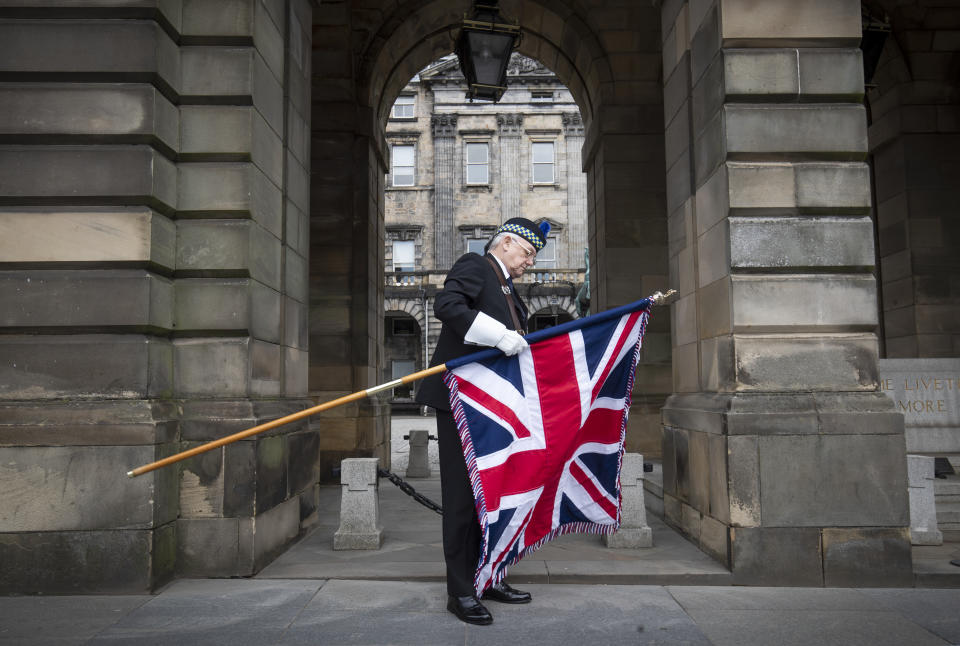 "Standard bearer Geoff Williams from Legion Scotland outside Edinburgh City Chambers before the St Valery commemoration to remember the thousands of Scots who were killed or captured during ""the forgotten Dunkirk"" 80 years ago."