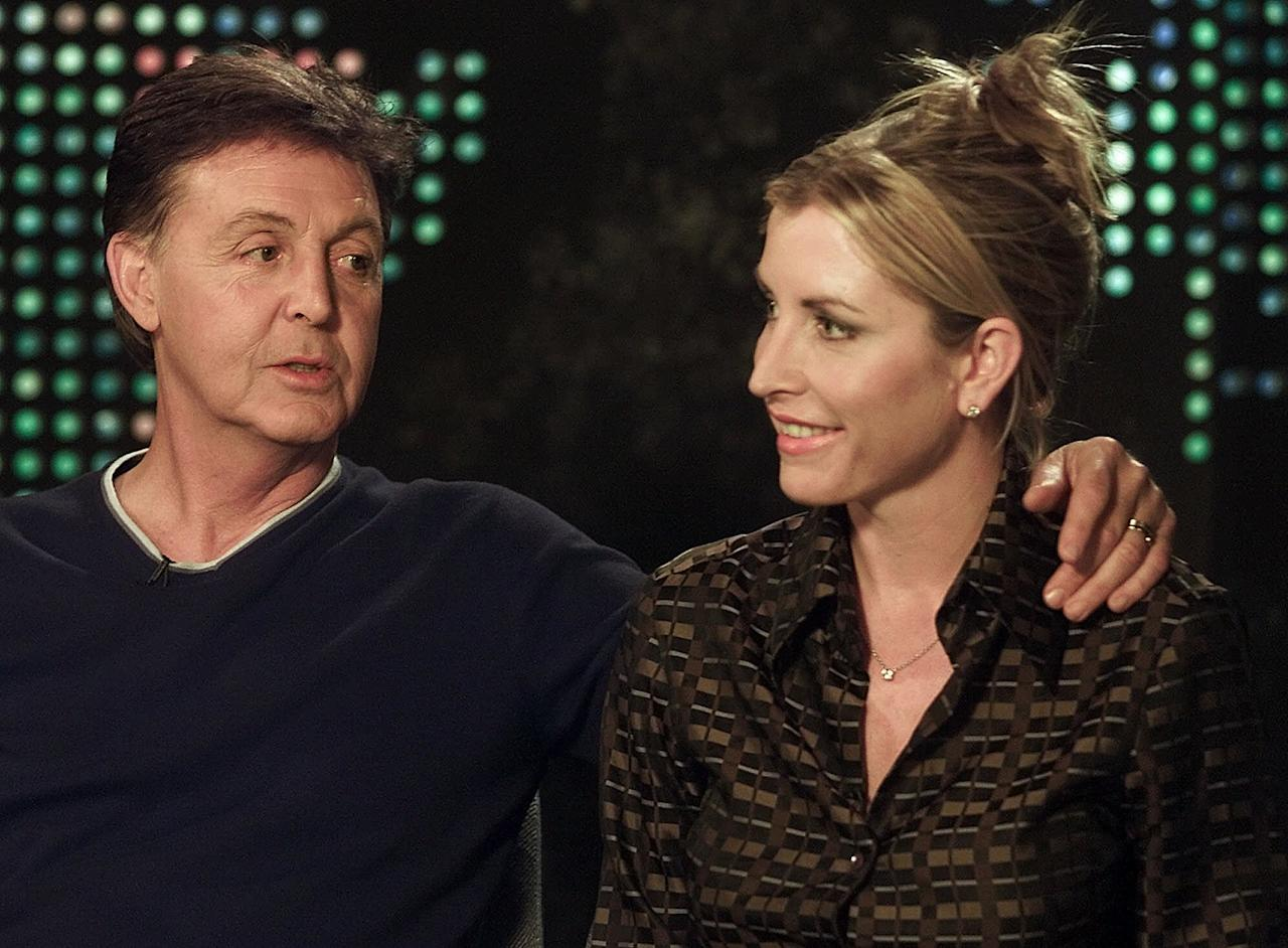 FILE - In this Tuesday, June 12, 2001 file photo, Paul McCartney, left, talks about the possibility of future worldwide ban of land mines, with his then girlfriend Heather Mills, during an interview with Larry King at the CNN studios in Los Angeles. McCartney turned 70 years of age Monday June 18, 2012. (AP Photo/Damian Dovarganes, File)