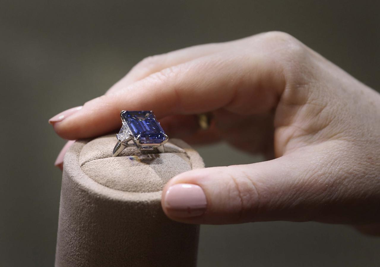 <p>The Oppenheimer Blue, a 14.62 carat fancy vivid blue diamond, held the previous gemstone record after being sold at the Christie's Magnificent Jewels sale in Geneva in 2016 for £40 million. The emerald-cut stone was previously owned by British diamond dealer Sir Philip Oppenheimer. (Philip Toscano/PA Images) </p>