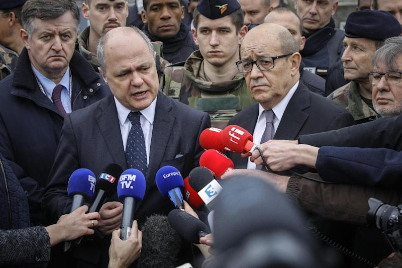 French Interior Minister Bruno le Roux, center left, and French Defense Minister Jean-Yves le Drian, center right, and Paris Airports CEO Augustin de Romanet answer reporters at Orly airport, south of Paris, Saturday, March, 18, 2017. A man was shot to death Saturday after trying to seize the weapon of a soldier guarding Paris' Orly Airport, prompting a partial evacuation of the terminal, police said. (AP Photo/Kamil Zihnioglu)
