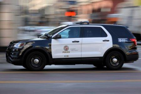 A Los Angeles Police Department cruiser with lights and sirens going speeds down on a city street in Los Angeles, California, U.S. August 10, 2017. REUTERS/Mike Blake