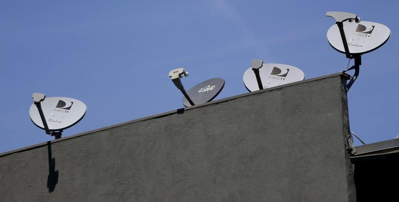 A satellite dish from Dish Network is pictured along with satellite dishes from Direct TV in Pasadena