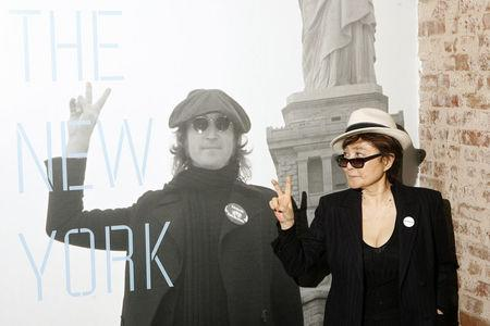 "FILE PHOTO: Yoko Ono gestures as she unveils the ""John Lennon: The New York City Years"" exhibit at the Rock & Roll Hall of Fame Annex in"