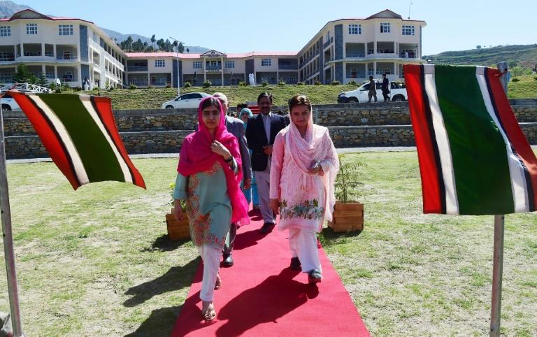 Malala Yousafzai arrives with Pakistani Minister of State for Information and Broadcasting, Maryam Aurangzeb, at the all-boys Swat Cadet College Guli Bagh