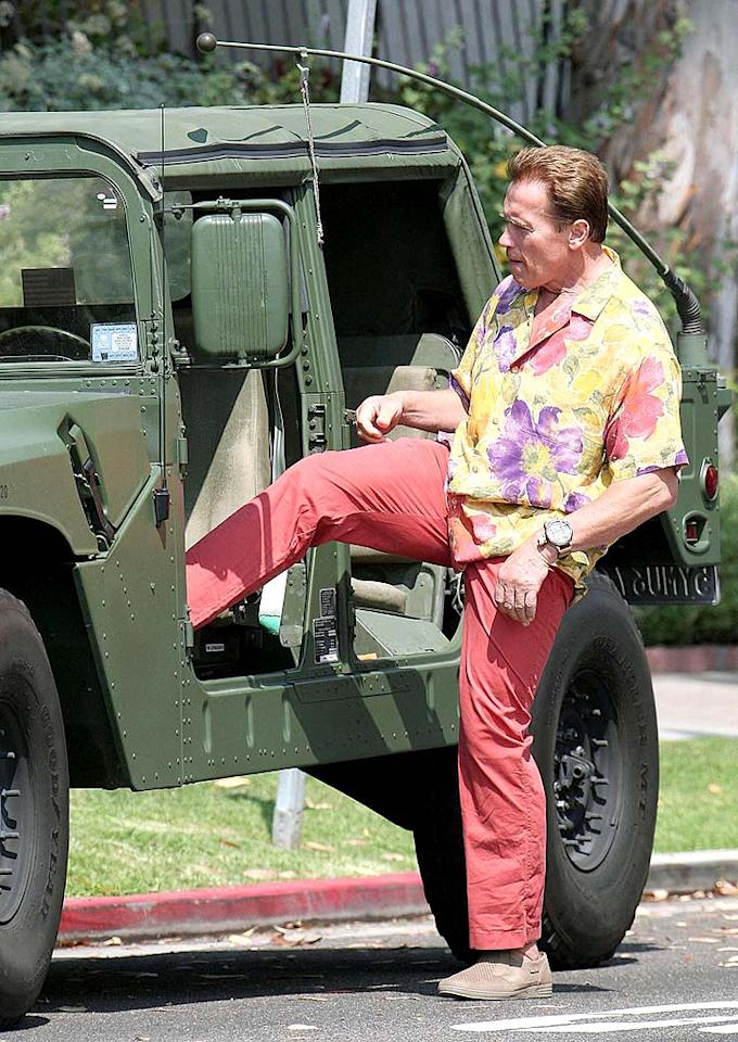 "Is Arnold Schwarzenegger heading home from a super sale at Tommy Bahama? Those pastels are painful to look at. Gaz Shirley/<a href=""http://www.pacificcoastnews.com/"" target=""new"">PacificCoastNews.com</a> - July 13, 2008"
