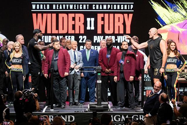 "<span class=""element-image__caption"">Deontay Wilder and Tyson Fury jaw at one another from a distance on Friday after weighing in for their heavyweight title fight at the MGM Grand.</span> <span class=""element-image__credit"">Photograph: Étienne Laurent/EPA</span>"