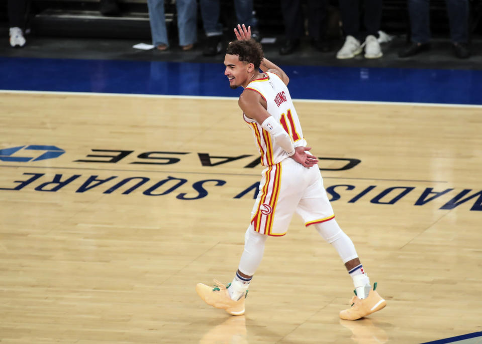 Atlanta Hawks guard Trae Young (11) waves to the crowd after making a three point shot against the New York Knicks in the fourth quarter of Game 5 of an NBA basketball first-round playoff series Wednesday, June 2, 2021, in New York. (Wendell Cruz/Pool Photo via AP)