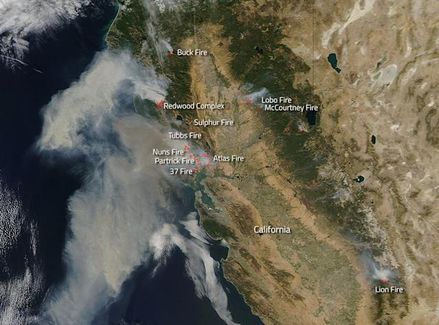 <p>Fires broke out quickly this past weekend in northern California. NASA's Aqua satellite collected this natural-color image with the Moderate Resolution Imaging Spectroradiometer, MODIS, instrument on Oct. 9, 2017. Actively burning areas (hot spots), detected by MODIS's thermal bands, are outlined in red. Each hot spot is an area where the thermal detectors on the MODIS instrument recognized temperatures higher than background. When accompanied by plumes of smoke, as in this image, such hot spots are diagnostic for fire. (Photo: NASA/Jeff Schmaltz LANCE/EOSDIS MODIS Rapid Response Team, GSFC) </p>