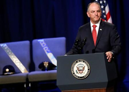 Louisiana Governor John Bel Edwards speaks during a memorial service for three slain Baton Rouge police officers at Healing Place Church in Baton Rouge