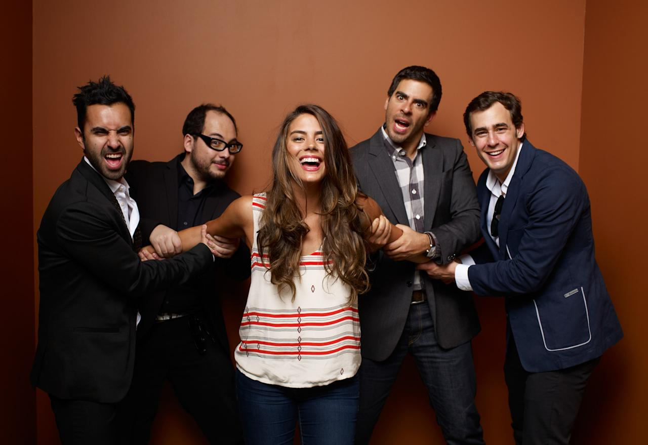 "TORONTO, ON - SEPTEMBER 11:  (L-R) Actor Matias Lopez, Writer/Director Nicolás López, Actress Lorenza Izzo, Writer/Producer/Actor Eli Roth and Actor Ariel Levy of ""Aftershock"" poses at the Guess Portrait Studio during 2012 Toronto International Film Festival on September 11, 2012 in Toronto, Canada.  (Photo by Matt Carr/Getty Images)"