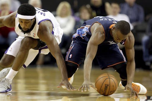 Charlotte Bobcats guard Kemba Walker, right, grabs a loose ball ahead of Sacramento Kings forward John Salmons during the second quarter of an NBA basketball game in Sacramento, Calif., Sunday, March 3, 2013. (AP Photo/Rich Pedroncelli)