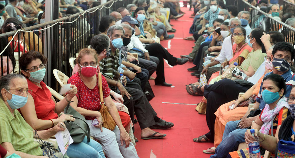 MUMBAI, INDIA  APRIL 27: People wait in a queue to get vaccinated against Covid-19 at BKC Jumbo Covid-19 Vaccination Centre, on April 27, 2021 in Mumbai, India. (Photo by Satish Bate/Hindustan Times via Getty Images)