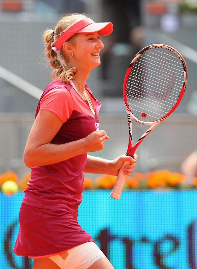 MADRID, SPAIN - MAY 08: Ekaterina Makarova of Russia celebrates defeating Victoria Azarenka of Belarus during day five of the Mutua Madrid Open tennis tournament at the Caja Magica on May 8, 2013 in Madrid, Spain. (Photo by Julian Finney/Getty Images)