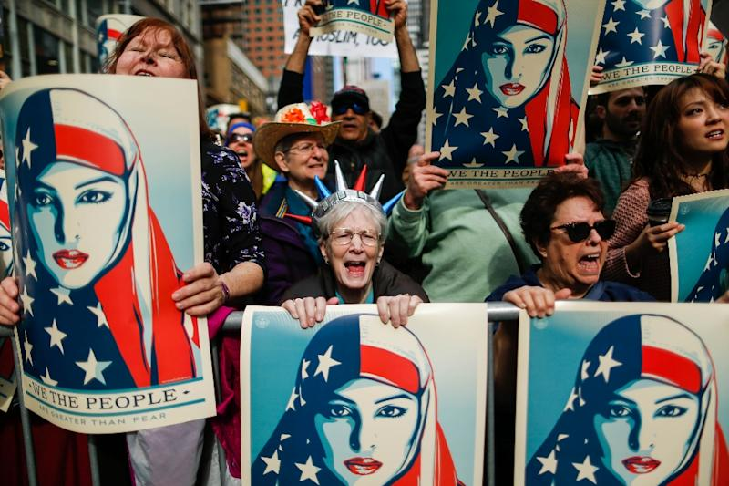 People take part in a rally called 'I Am A Muslim Too' in a show of solidarity with American Muslims at Times Square in New York City (AFP Photo/EDUARDO MUNOZ ALVAREZ)