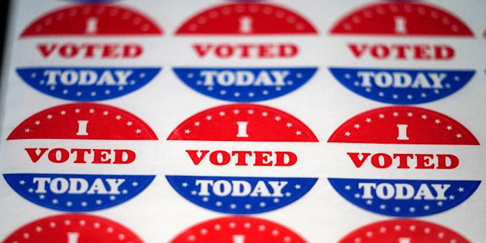 """Vote stickers are seen at a satellite election office at Temple University's Liacouras Center, Tuesday, Sept. 29, 2020, in Philadelphia. <p class=""""copyright"""">AP Photo/Matt Slocum</p>"""