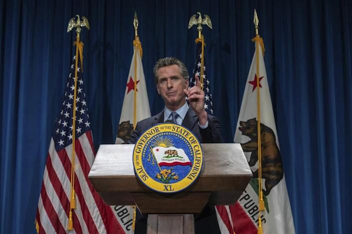 California Gov. Gavin Newsom answers questions from reporters after delivering his revised budget proposal at a press conference on Friday, May 14, 2021 in Sacramento, Calif. Gov. Newsom proposed a $268 billion state budget that is one-third larger than the state's current spending plan, fueled by surging state tax revenues and federal stimulus money. (Renee C. Byer/The Sacramento Bee via AP)