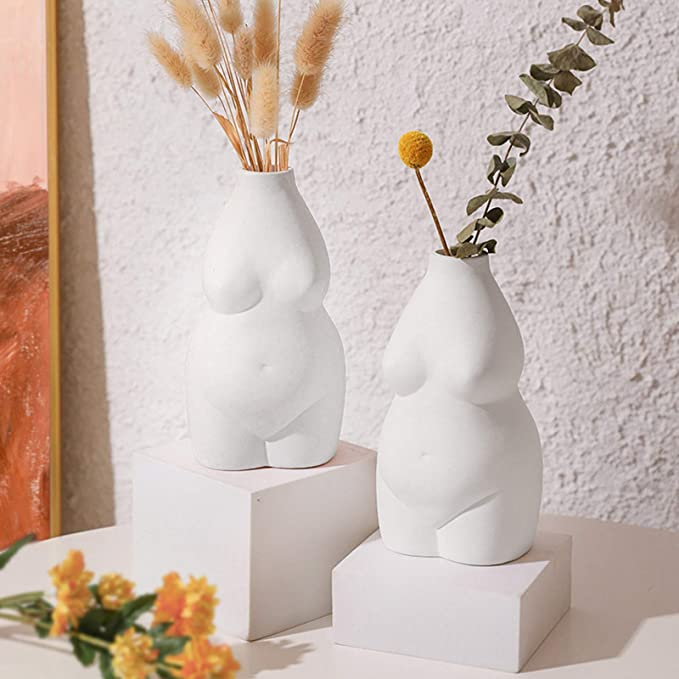 """<h3>Body Ceramic Flower Vase</h3><br>We can see it now: this cool-girl vase, <a href=""""https://www.refinery29.com/en-us/pampas-grass-dried-flower-trend"""" rel=""""nofollow noopener"""" target=""""_blank"""" data-ylk=""""slk:accented with pampas grass"""" class=""""link rapid-noclick-resp"""">accented with pampas grass</a>, shimmering atop our morning-sunlight and <a href=""""https://www.refinery29.com/en-us/2020/02/9451157/glossier-skywash-eyeshadow-review"""" rel=""""nofollow noopener"""" target=""""_blank"""" data-ylk=""""slk:Glossier-product-filled dressers"""" class=""""link rapid-noclick-resp"""">Glossier-product-filled dressers</a>. <br><br><strong>Besimple</strong> Body Flower Vase, $, available at <a href=""""https://amzn.to/3syQ5D5"""" rel=""""nofollow noopener"""" target=""""_blank"""" data-ylk=""""slk:Amazon"""" class=""""link rapid-noclick-resp"""">Amazon</a>"""