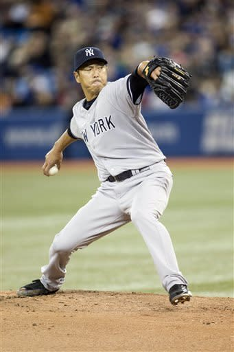 New York Yankees starting pitcher Hiroki Kuroda works against the Toronto Blue Jays during the first inning of a baseball game in Toronto on Saturday, April 20, 2013. (AP Photo/The Canadian Press, Chris Young)