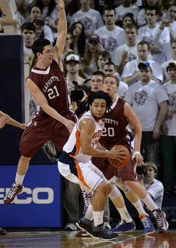 Bucknell's Bryson Johnson (12) looks for room to pass around Lafayette's Zach Rufer (21) and other defends during the first half of an NCAA college basketball game for the Patriot League men's tournament title, Wednesday, March 13, 2013, in Lewisburg, Pa. (AP Photo/Ralph Wilson)