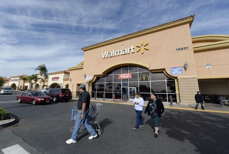 Customers walk outside a Walmart store in the Porter Ranch section of Los Angeles