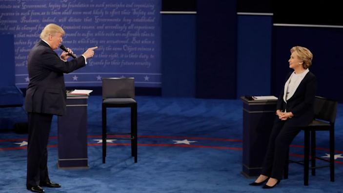 2016 AP YEAR END PHOTOS - Republican presidential nominee Donald Trump speaks to Democratic presidential nominee Hillary Clinton during the second presidential debate at Washington University in St. Louis, on Oct. 9, 2016. (AP Photo/Patrick Semansky, File)