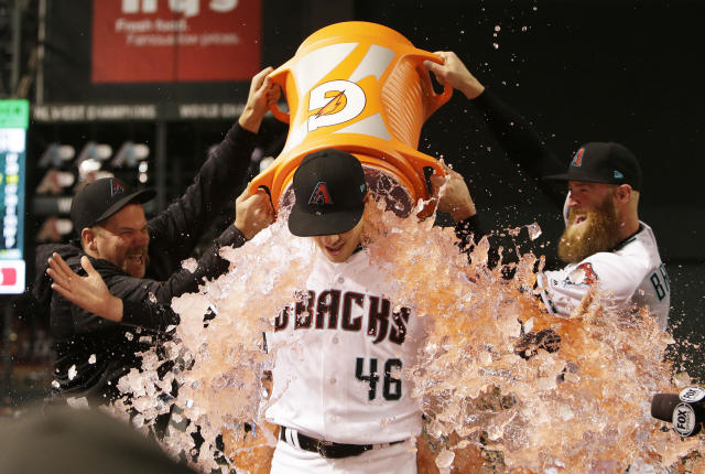 Arizona Diamondbacks Zack Godley, left, and Archie Bradley pour Gatorade over Patrick Corbin (46) after defeating the San Francisco Giants 1-0 during a baseball game, Tuesday, April 17, 2018, in Phoenix. Corbin pitched a complete game, one hit shut-out. i(AP Photo/Rick Scuteri)