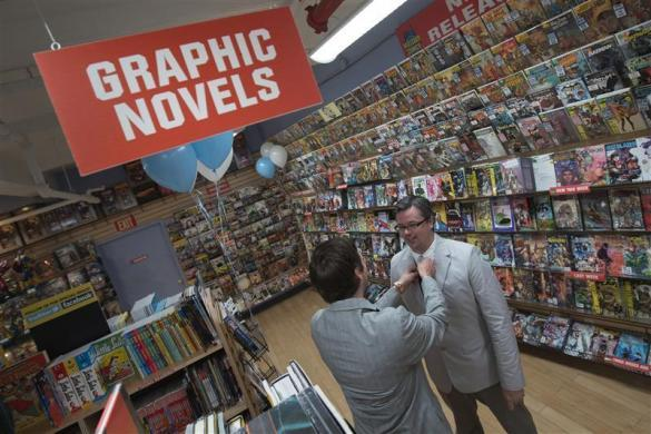 Jason Welker (L) adjusts the tie of Scott Everhart ahead of their wedding ceremony at a comic book retail shop in Manhattan, New York June 20, 2012.