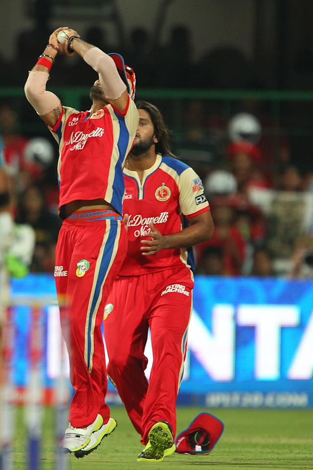 Virat Kohli takes the catch to dismiss Yuvraj Singh during match 31 of the Pepsi Indian Premier League between The Royal Challengers Bangalore and The Pune Warriors India held at the M. Chinnaswamy Stadium, Bengaluru  on the 23rd April 2013..Photo by Ron Gaunt-IPL-SPORTZPICS ..Use of this image is subject to the terms and conditions as outlined by the BCCI. These terms can be found by following this link:..https://ec.yimg.com/ec?url=http%3a%2f%2fwww.sportzpics.co.za%2fimage%2fI0000SoRagM2cIEc&t=1495865138&sig=TXx9Czpx81CZiwU.TZ38sQ--~C