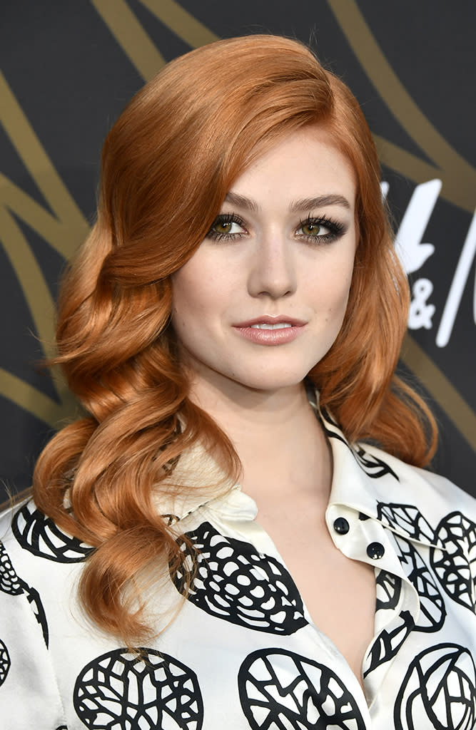 <p>McNamara's hair colorist deserves an Oscar for creating this brilliant hue. The fiery red-orange shade adds warmth to her fair complexion and makes her hazel eyes stand out from her smoky eyeshadow. (Photo: Frazer Harrison/Getty Images) </p>