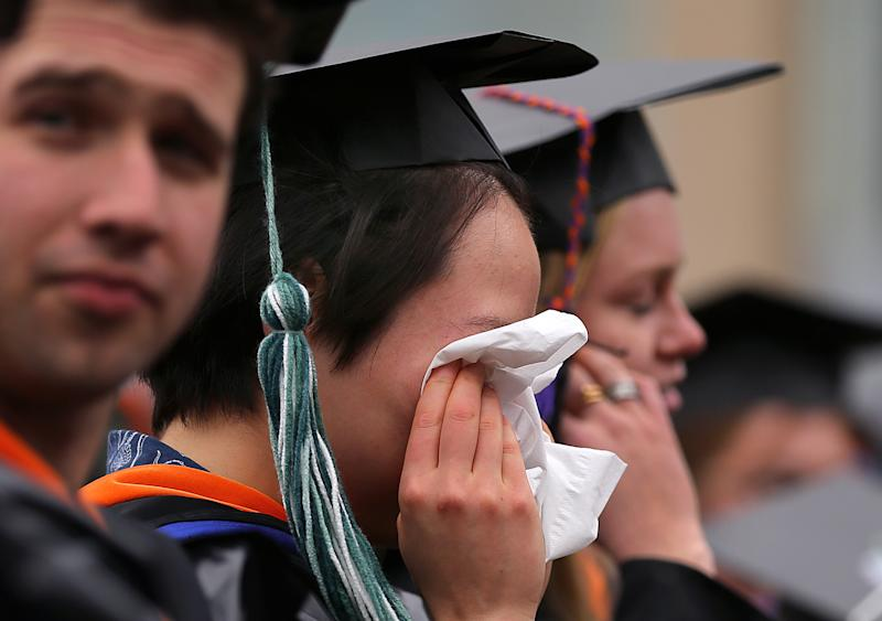 "NEEDHAM, MA - MARCH 12: Emotions run high at the Olin College of Engineering ""Fauxmencement"" for senior students on March 12, 2020, two months early, held because of coronavirus fears in Needham, MA. (Photo by John Tlumacki/The Boston Globe via Getty Images)"
