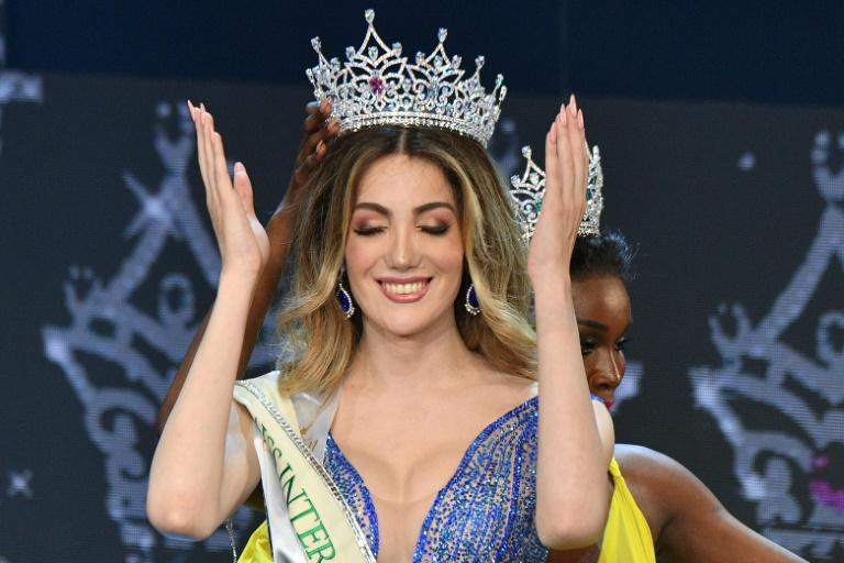 Mexico's Valentina Fluchaire is crowned Miss International Queen 2020 by last year's winner Jazelle Barbie Royale of the United States