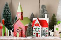 """<p>Make a plain-paper town merry. Transform a ready-made, unadorned card-stock village by customizing the buildings with wrapping paper. Finish off the scene with tinsel wreaths, tabletop trees, and toy deer.</p><p><a class=""""link rapid-noclick-resp"""" href=""""https://go.redirectingat.com?id=74968X1596630&url=https%3A%2F%2Fwww.worldmarket.com%2Fsearch.do%3Fquery%3Dbottle%2Bbrush%2Btrees&sref=https%3A%2F%2Fwww.countryliving.com%2Fhome-design%2Fdecorating-ideas%2Fadvice%2Fg1247%2Fholiday-decorating-1208%2F"""" rel=""""nofollow noopener"""" target=""""_blank"""" data-ylk=""""slk:SHOP BOTTLE BRUSH TREES"""">SHOP BOTTLE BRUSH TREES</a><br></p>"""