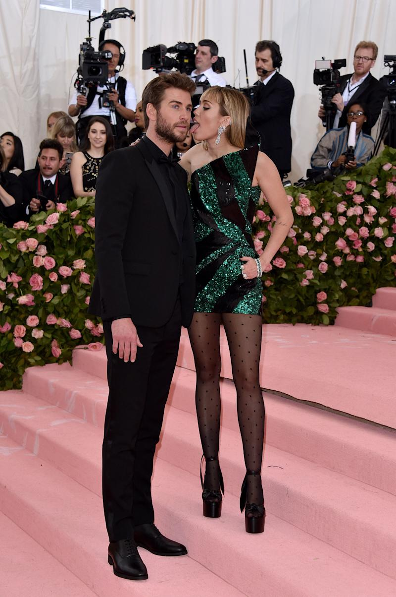 Miley licks Liam on the Met Gala red carpet. Photo: Getty