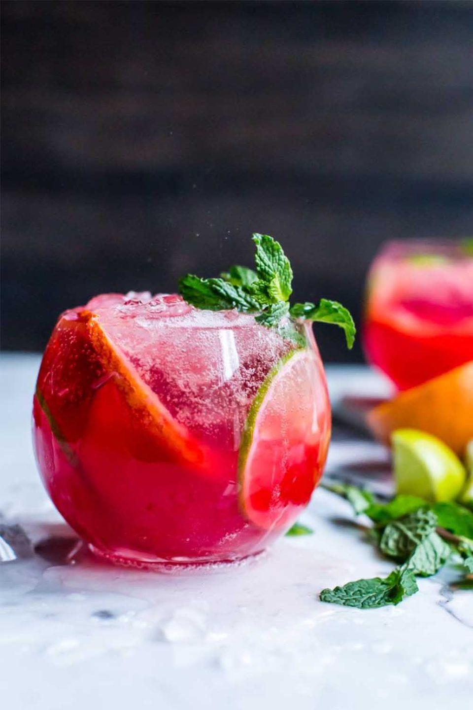 """<p>You don't have to wait until next summer for your favorite citrus and minty libation. This zingy blood orange version will convince you that mojitos aren't just for hot and humid days. </p><p><a class=""""link rapid-noclick-resp"""" href=""""https://vanillaandbean.com/blood-orange-mojitos/"""" rel=""""nofollow noopener"""" target=""""_blank"""" data-ylk=""""slk:GET THE RECIPE"""">GET THE RECIPE</a></p>"""