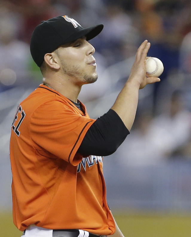 Miami Marlins' Jose Fernandez prepares to pitch during the first inning of a baseball game against the Los Angeles Dodgers, Sunday, May 4, 2014, in Miami. (AP Photo/Wilfredo Lee)