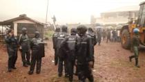 Police officers stand at the site after a mudslide in the mountain town of Regent, Sierra Leone August 14, 2017 in this still image taken from a video. REUTERS/Reuters TV