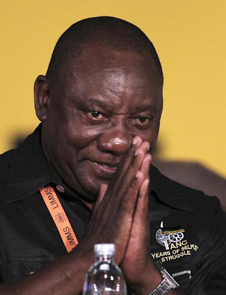 African National Congress (ANC) newly elected deputy president Cyril Ramaphosa, acknowledges the cheering from ANC members of the audience during their elective conference at the University of the Free State in Bloemfontein, South Africa, on Tuesday, Dec. 18, 2012. (AP Photo/Themba Hadebe)