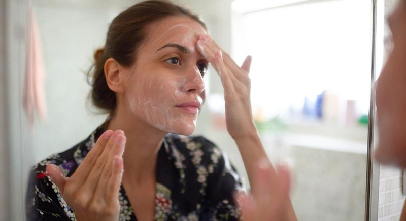 The man's girlfriend, pictured here by a stock image, suffered from an acne outbreak after drinking dairy. [Photo: Getty]