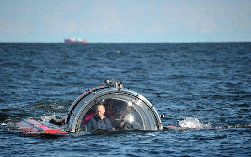 Russian President Vladimir Putin submerges on board Sea Explorer 5 bathyscaphe off the island of Gogland 180 kilometers (110 miles) west of St. Petersburg, Russia, Monday, July 15, 2013, Putin rode a small submersible craft 60 meters (200 feet) down to see the remains of the naval frigate Oleg, which sank in 1869, Russian news reports said. Putin's latest media event was modest by the stunt-happy Russian leader's standards, a half-hour trip to the bottom of the Gulf of Finland to see a shipwreck. (AP Photo/RIA-Novosti, Alexei Nikolsky, Presidential Press Service)