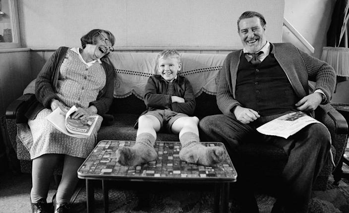 """A picture of Judi Dench, Jude Hill, and Ciarán Hinds in """"Belfast."""""""