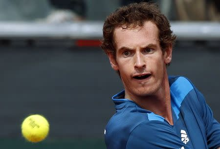 Britain's Murray returns a shot against Italy's Seppi during their Davis Cup quarter-final tennis match in Naples