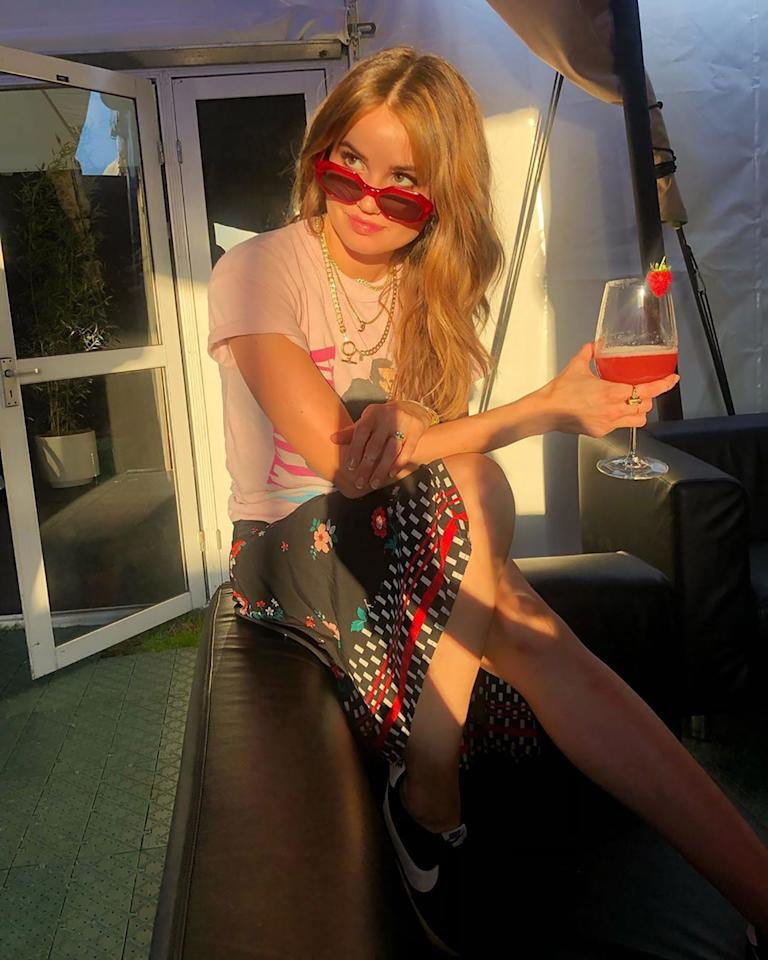 """<p>The<a href=""""https://people.com/tv/debby-ryan-engaged-josh-dun/""""><em>Insatiable</em>star</a> posed in red sunglasses with a matching fruity cocktail in hand and <a href=""""https://www.instagram.com/p/B4qAgYaAfOA/?igshid=13i1we3u8szua"""">commented</a> on how quickly the seasons pass.</p>"""