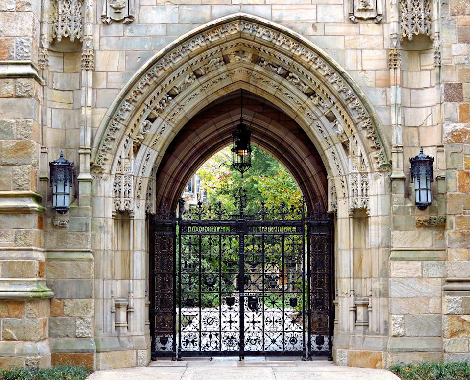 This decorative iron gate is the entrance to the Memorial Quadrangle on the campus of Yale University. The gate beneath Harkness Tower, crafted by Samuel Yellin, is the most ornate of his many works at Yale.